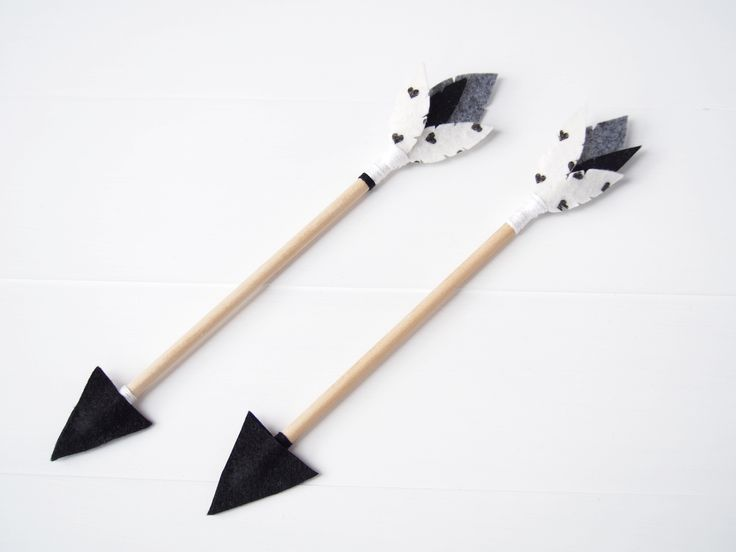 Our 'Monochrome madness' felt arrow set includes 2 arrows that have been handmade with quality felt in black, grey and white on a wooden dowel.Each arrow features slightly different colours and patterns of satin embroidery cotton which gives this set a unique tribal look.  Also available as a custom order in any colour to match your little ones room.Measuring approximately 26cm (10 inches) in size from the tip of the arrow to the top of the felt feathers, they are sm...