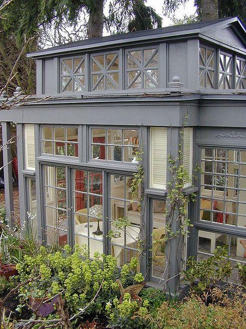 Mini conservatory, 43 recycled glass windows & doors.