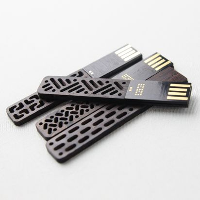 Wooden USB sticks by Chinese company Then. The patterns are inspired by traditional Chinese window frames. Quite beautiful.