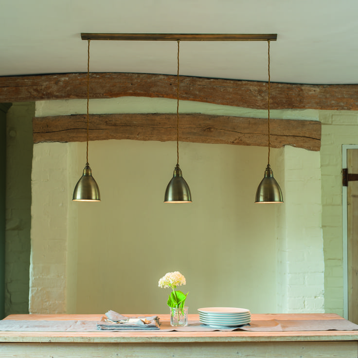 Triple pendant (shown in antiqued brass) is ideal for a kitchen or over a table, kitchen island or worktop. Hangs from a 1m track (screwed to the ceiling) and requires one set of cables for the whole light. The overall maximum height is 92cm. RRP £209. Currently out of stock ~ lead time 2 weeks.