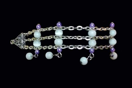 Kathy Stewart (Canada) loves creating one-of-a-kind custom jewelry. Here is a purple purple and white cat's eye bracelet. For more please go to www.glamnglitter.com
