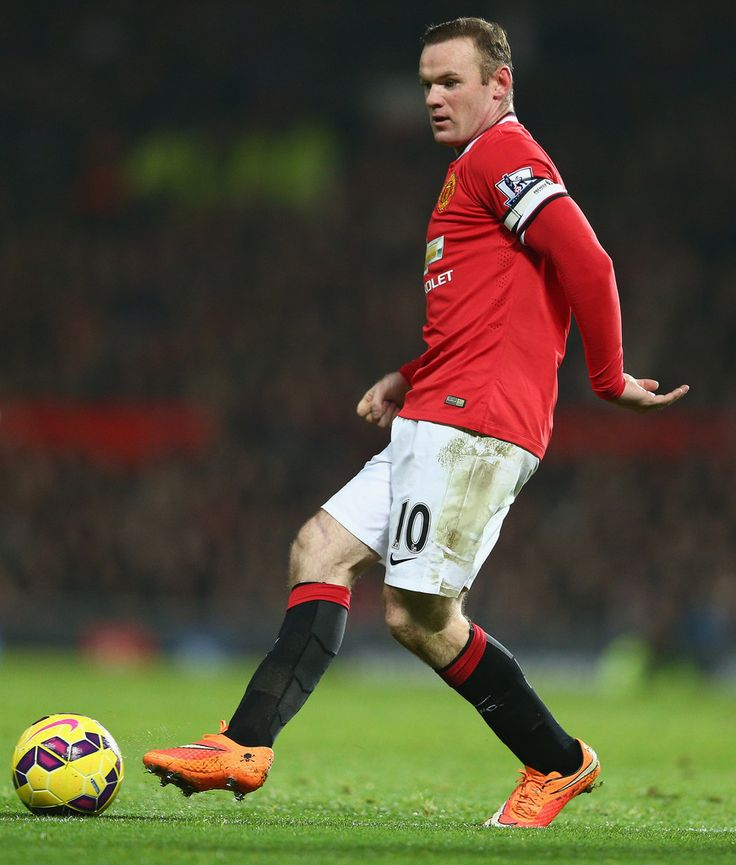 Wayne Rooney of Manchester United in action during the Barclays Premier League match between Manchester United and Hull City at Old Trafford on November 29, 2014 in Manchester, England.