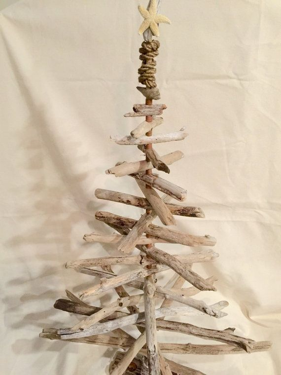 Make a statement with this magnificent driftwood Christmas with nautical accents that tree stands 5 feet tall! With rustic copper bead