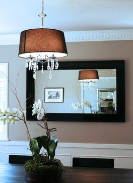Dining room, chandelier, drum pendant with crystals, elegance, taupe walls, mirror in dining room, crown moulding.  Design by Marilynn Taylor