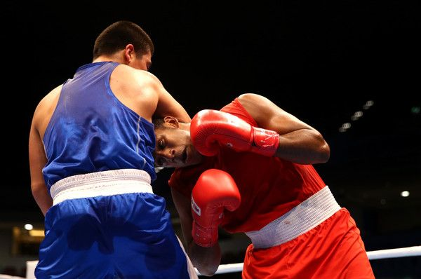 Arlen Lopez Photos - Arlen Lopez of Cuba (red) fights Bektemir Melikuziev of Uzbekistan in the final of the Men's Middle Weight during the AIBA World Boxing Championships Doha 2015 at the Ali Bin Hamad Al-Attiya Arena on October 14, 2015 in Doha, Qatar. - AIBA World Boxing Championships Doha