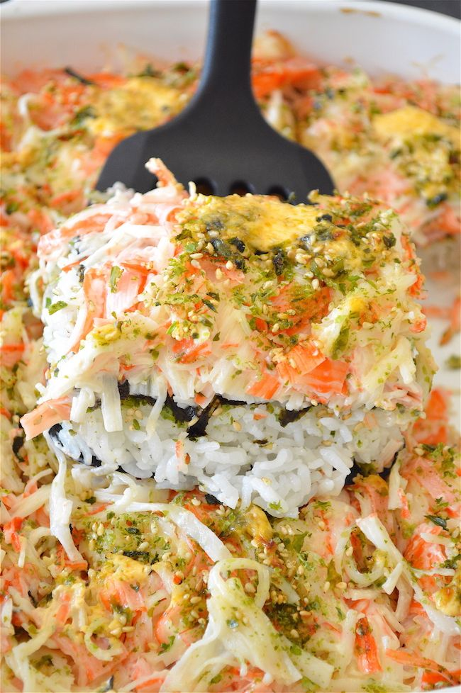 """This is a Sushi Bake! It's basically the best parts ofa giant California roll made 100x larger and requires no special sushi chef skills! This """"casserole"""" is filled with a mouth-watering mayo/crab meat mixture, rice, nori, and topped with a yummy and simple spicy mayo sauce!"""