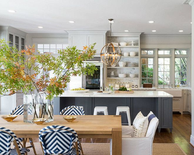 i like the lighter gray cabinets with the darker colored island love the blue and