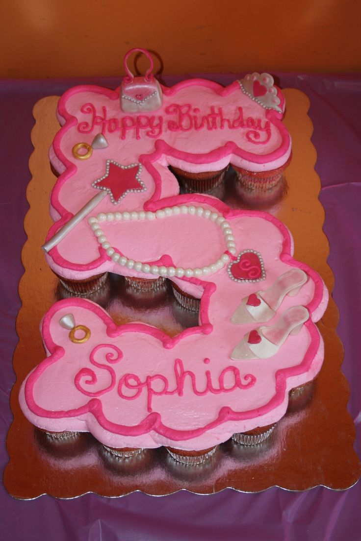 Princess Fifth Birthday Cupcake Cake A cupcake cake for a princess' fifth birthday. Decorations modeled after party supplies (shown in...
