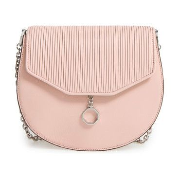 jael leather crossbody bag by Louise et Cie. Pebbled leather perfectly juxtaposes the smooth flap on a must-have crossbody bag highlighted by gleaming hardware. W...