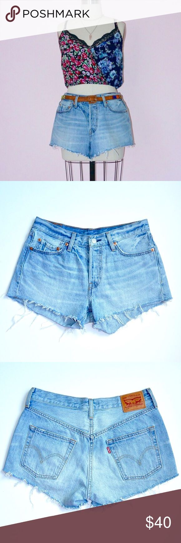 """New Levi's Blue Jean Shorts Lana Del Rey probably rocks these. You should too. Levi Strauss 501 blue jean shorts are the epitome of classic California cool. Features 5 pocket styling, mid-rise fit, and iconic Levi's patch detail.  Brand: Levi Strauss & Co. Size: 27* (*sizes are arbitrary! see measurements) Material: 100% cotton Measurement around top edge: 30"""" Measurement around hip point: 38""""  Length along outer edge: 11"""" Length of rise (from top of button to crotch): 9.5"""" Levi's Shorts…"""