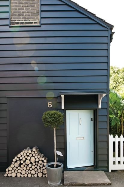 Great article on painting your exterior. A sedate blue door (Blue Ground No. 210, house is Off-Black No. 57) may be calming, but the owners rank 7th happiest out of 10, with grey doors taking last place.