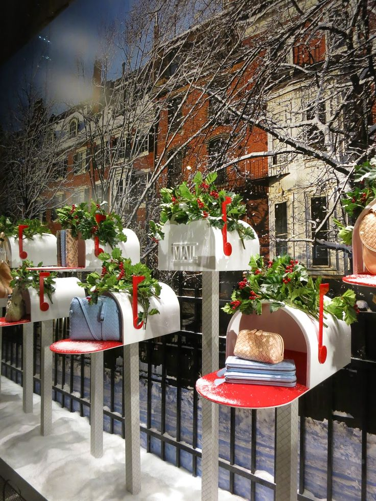 A great holiday window that takes the idea of gift giving to a new level.  It's also a great way to subtly convey the message that you offer shipping.