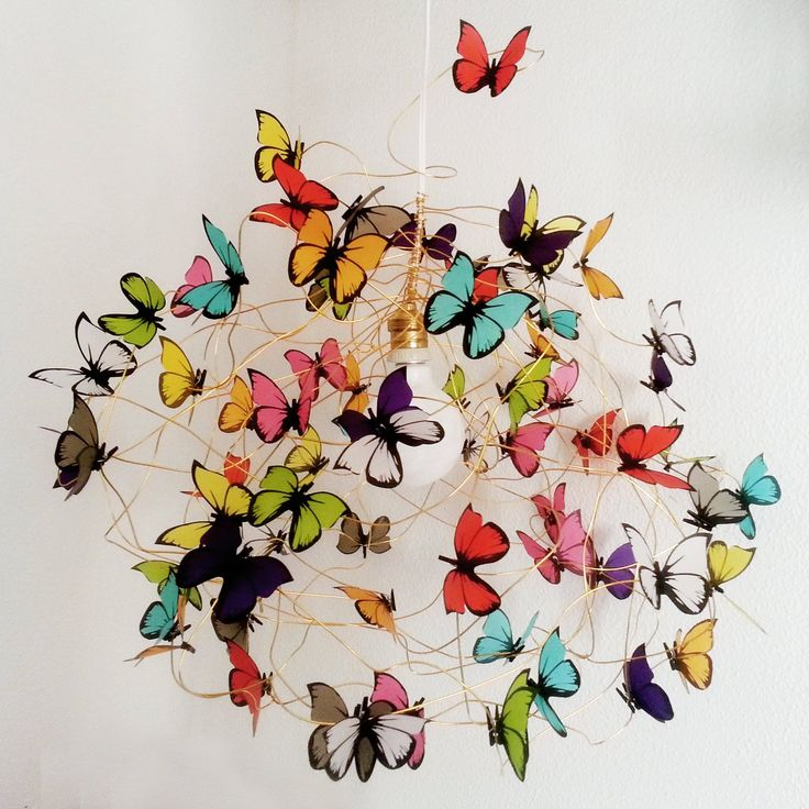 Hanging lamp made of white plastic wire, golden colored aluminium wire and multicolor butterflies made of vegetal translucent paper. Please allow 2-3 weeks for shipping.