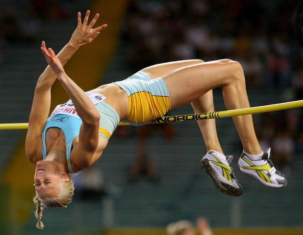 Carolina Kluft Photos - Carolina Kluft of Sweden clears the bar in the Womens High Jump during the IAAF Golden Gala at The Olympic Stadium on July 13, 2007 in Rome, Italy - IAAF Golden League - Rome