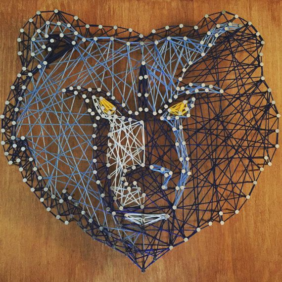 Handmade string art on 12x16 wood of the Memphis Grizzlies logo.