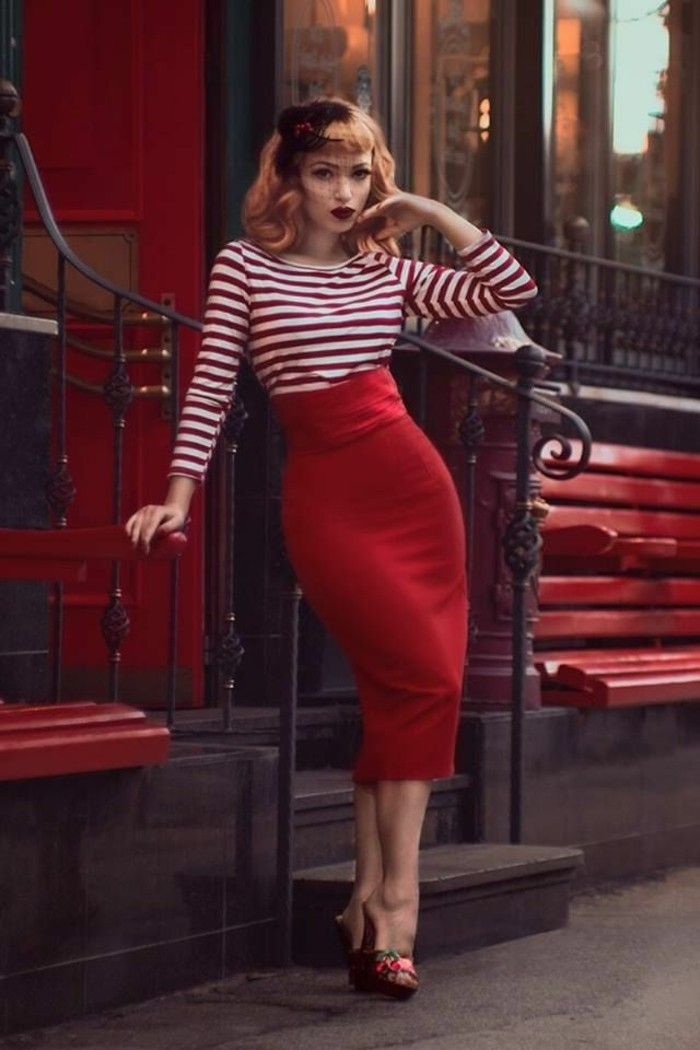 betty bangs, copper red haired woman with hair ornament and retro curls, red and white striped top and red pencil skirt, high heeled shoes