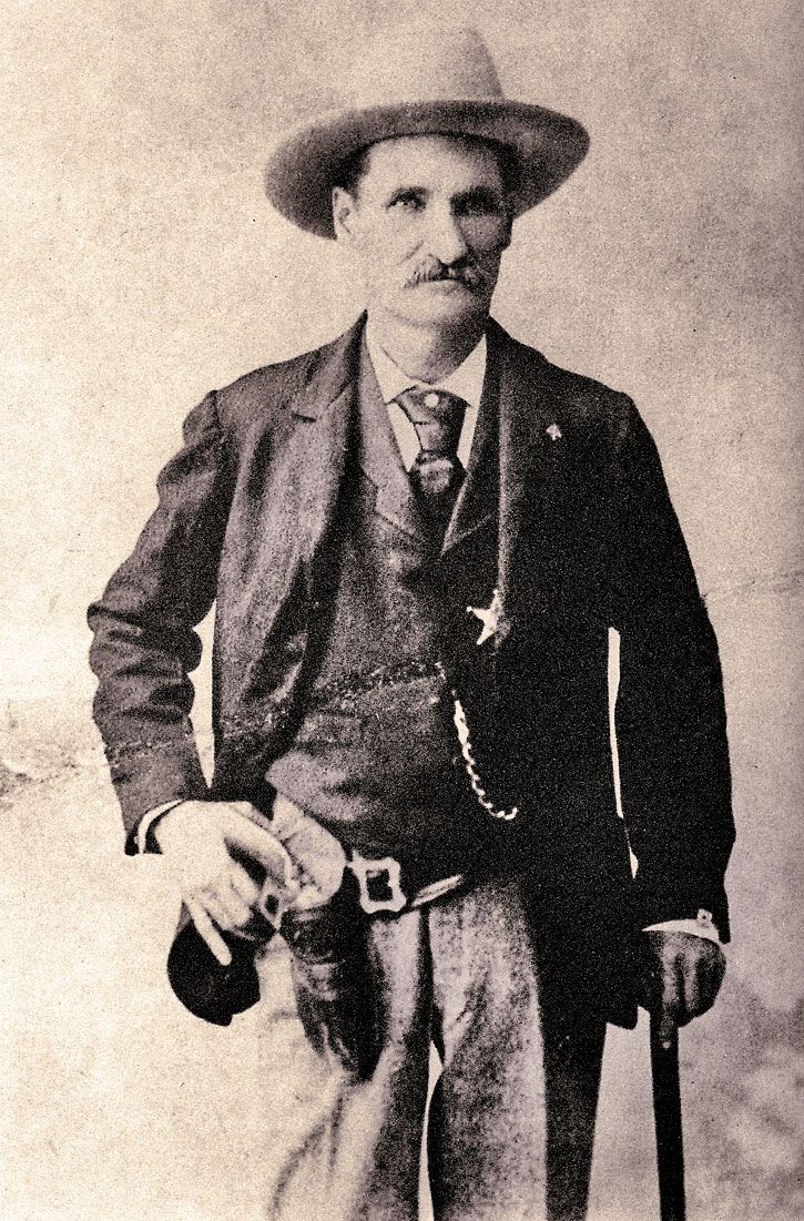 JOHN SELMAN — A figure of stealth and violence, John Selman famously killed gunfighters John Wesley Hardin and Bass Outlaw. Before Outlaw died in that 1894 gunfight, he did send a bullet to Selman's leg that led him to use a cane for the rest of his life. – True West Archives –