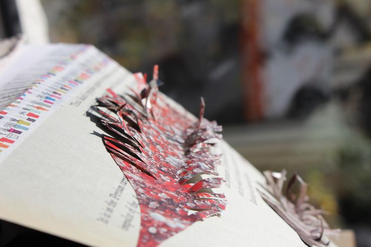 Cut paper feathers in my Dee Estuary sketchbook