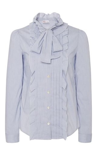 In a soft oxford blue, this **Red Valentino** blouse featured a ruffled bib detail at the front with a feminine neck tie.