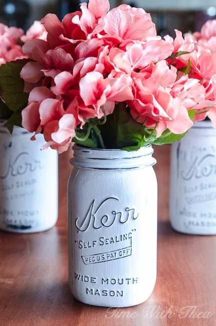 Coral silk hydrangea flowers in white distressed painted mason jars. / timewiththea.com