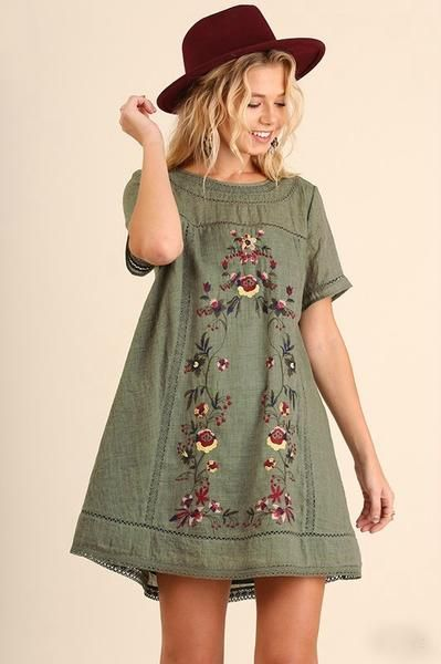 Classic A-line dress in Olive featuring floral embroidery throughout. Short-sleeved and fully lined. Pullover style with single button at nape of neck. Add a pair of our B123 Seamless Capri Leggings f