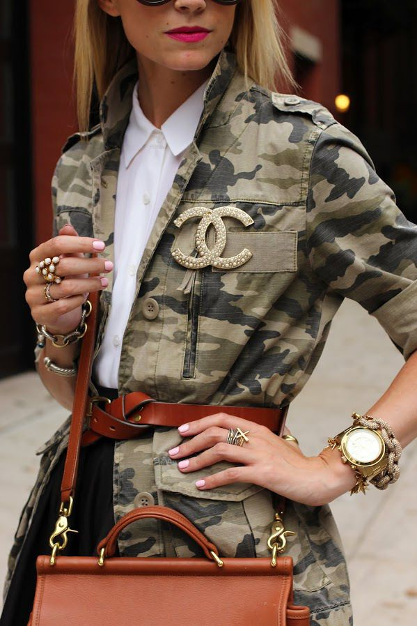 belted camo jacket + Chanel brooch and layered accessories