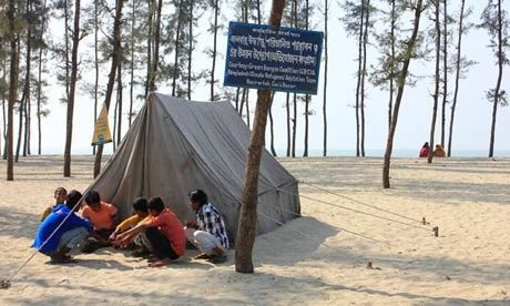 The island of Kutubdia in the Bay of Bengal Disappearing world … a project for climate refugees near Cox's Bazar, as people have been forced from islands such as Kutubdia in the Bay of Bengal. Photograph: Salman Saeed
