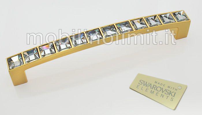 Maniglia Luxury 128 - Oro Lucido 12 Swarovski;                                        Dimensioni: Larghezza 140 mm. Profondità 25 mm. Altezza 13 mm. Interasse 128 mm. (Distanza tra i 2 fori di ancoraggio) MADE IN ITALY