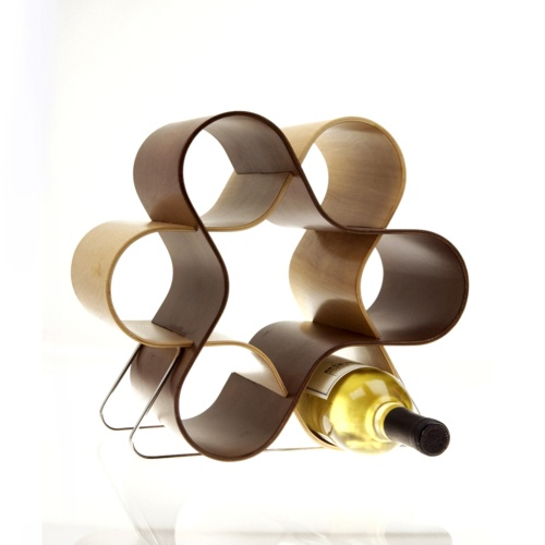 The Mint Wine Knot is a seven-bottle wine-rack that stores six regular sized bottles and one magnum or champagne bottle. Made from intersecting ribbons of molded plywood, its shape recalls the elegant, curved forms of midcentury modern design.
