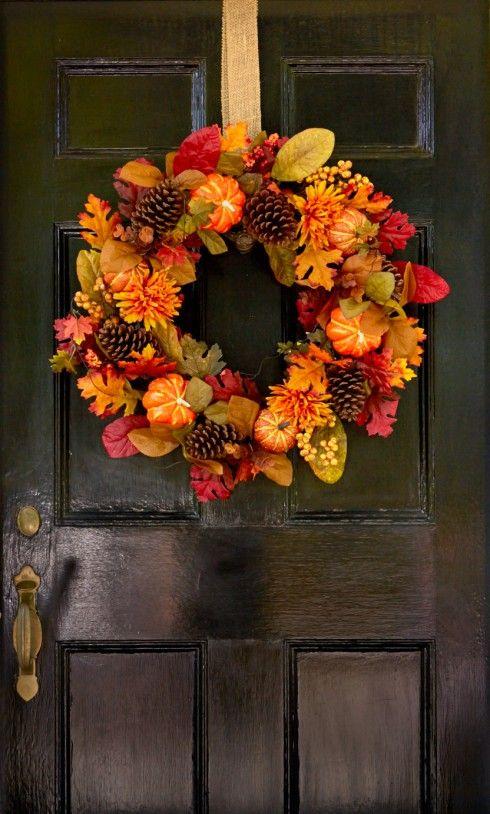 A colorful wreath can bring together all the elements of the outdoors! Pumpkins, leaves and pinecones carry curb appeal through Thanksgiving.