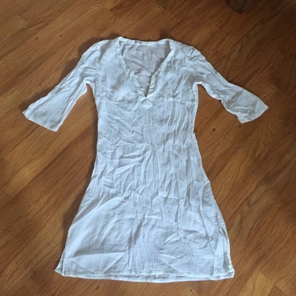 Athleta Sheer White Swimsuit Cover-Up Summer time... Althleta 3/4 sleeve sheer white swimsuit cover-up. Never worn but washed. Wrinkles well! Athleta Swim Coverups