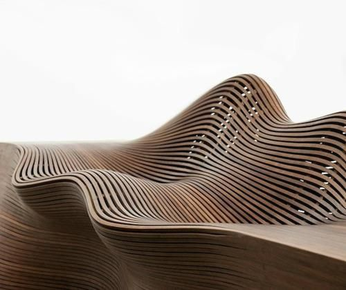 'Steam 20′ bench by Bae Sehwa  Up until the 'Steam 20′ bench, Bae Sehwa's steamed bentwood furniture has had a rib-like structure that is reminiscent of a ship's hull both in construction and shape. Steam 20 is a larger, more sculptural work, a departure from the vessel form with ribs that are closer together, except where they part to form sinuous water-like waves.