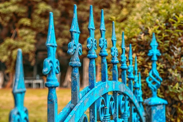 When you think of a wrought iron fence, your mind will naturally go to that grey or black matte finished fence. Although that style will always be classic, mix up your fence idea by painting the wrought iron. The blue wrought iron fence pictured here is not only interesting to look at, but it also looks worn.