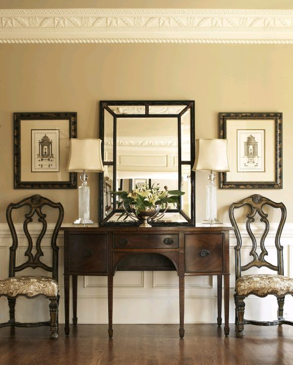 Chandeliers, Area Rugs, & Color: Transform Your Entryway With These Simple Tips.  Mirror. Lamp. Chair. Symmetrical.