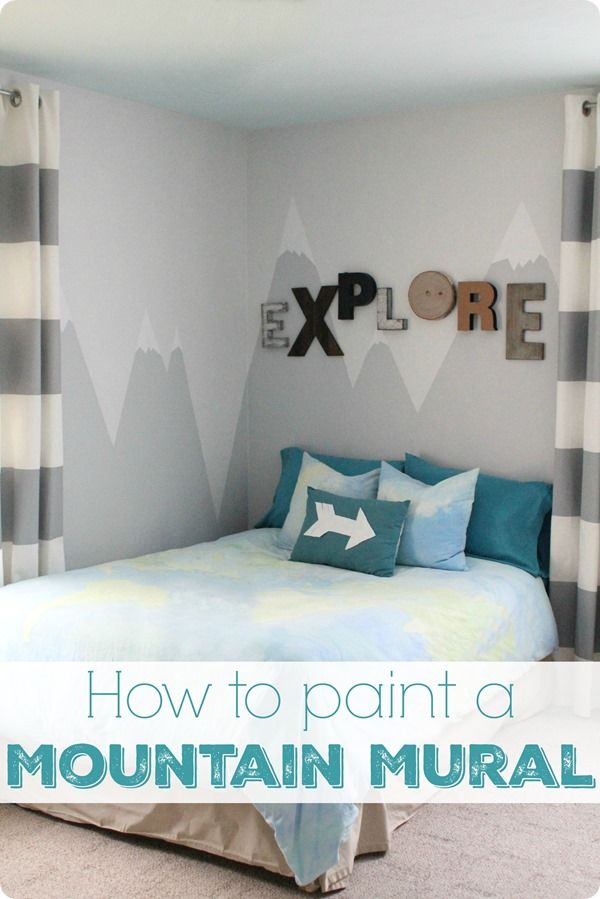 A simple painted mountain mural adds tons of personality to any kids room.