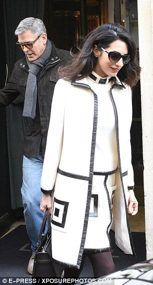 Simply stylish: Effortlessly showcasing her lithe frame, Amal looked chic in the wool A-li...