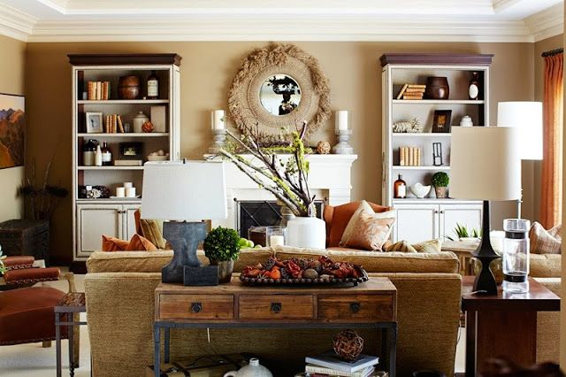 polished rustic  decor in a living room with a white modeled fireplace, white bookcase with white cabinets holding books and small keepsakes...