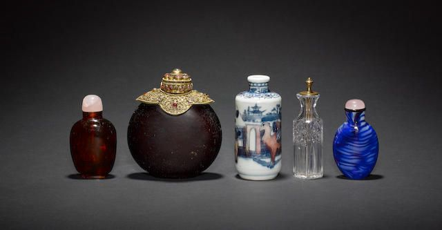 Four Chinese snuff bottles and a European Perfume, or other small, bottle, including: one with a Yongzheng mark in underglaze blue and red depicting Bactrian Camels