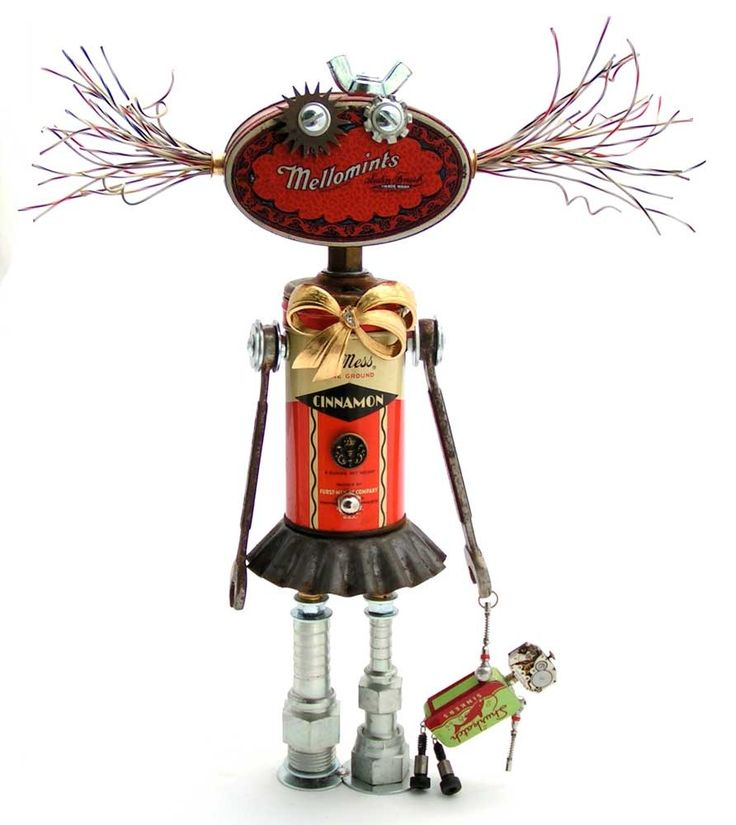 """The Dolly Mama"" Height: 12"" Principal Components: Spice, candy, and fishing sinker tins, telephone wire, clock gear, tartlet tin, hose fittings, watch movement, valve cores, shoulder bolts, brooch, button"