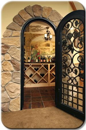 Wine cellar wall has a hand painted mural of a wine Turn closet into wine cellar