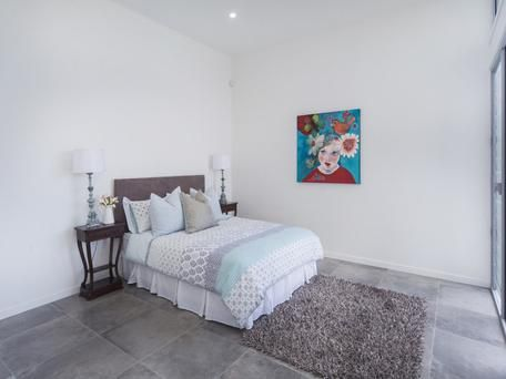 Grey and white guest bedroom