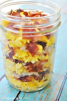 Scrambled eggs, hash browns,cheese, and bacon in a mason jar, warm it till cheese melts and all food is warm.