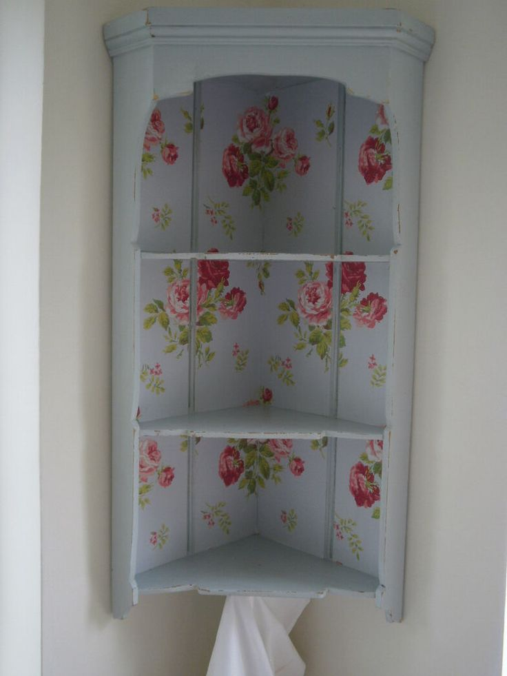 Vintage Corner Shelf Display Unit - Cath Kidston Wallpaper & Laura Ashley. I like the shape of the corner cabinet.