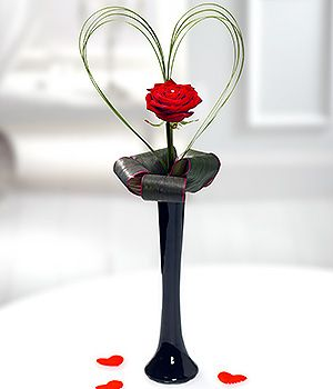 my heart a single red rose for valentines day in a black vase
