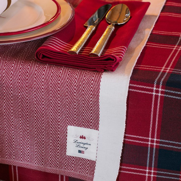 Our holiday runner brings a cheerful splash of color to your table in a rich woven red with white borders, creating a festive holiday ambience enhanced by the textured feel of quality cotton—a great way to elevate your table setting for the season.