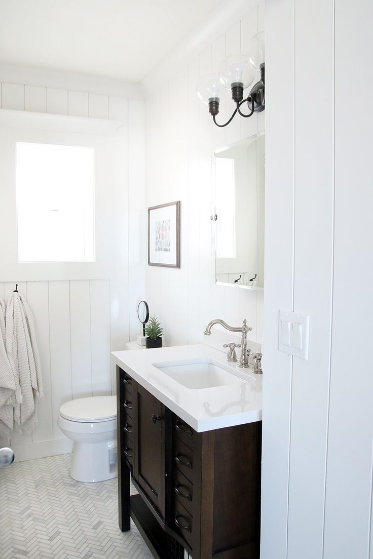 Classic white DIY spa bathroom renovation from our friends Chris Loves Julia.