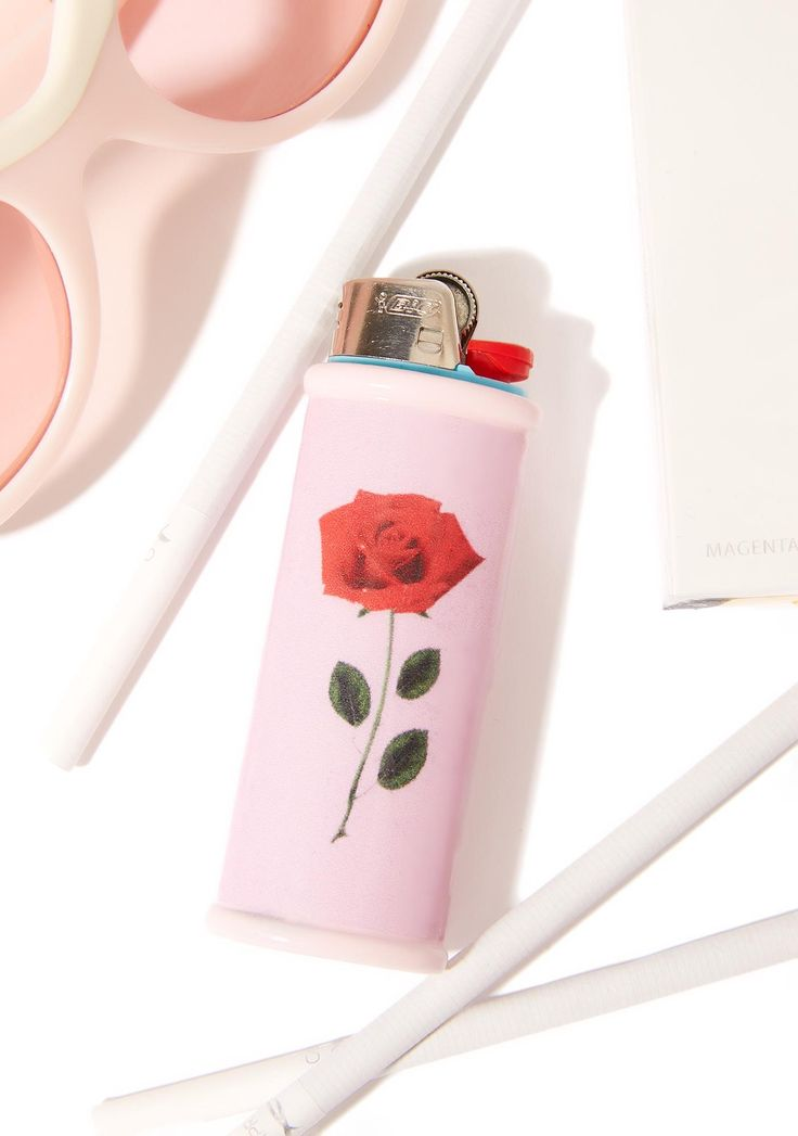 My Bubblegum Fantasy Single Rose Lighter Case will remind ya of that first love, bb. This dope handmade lighter case can house a standard size Bic lighter, and features a romantic minimal rose graphic on a pinky background.