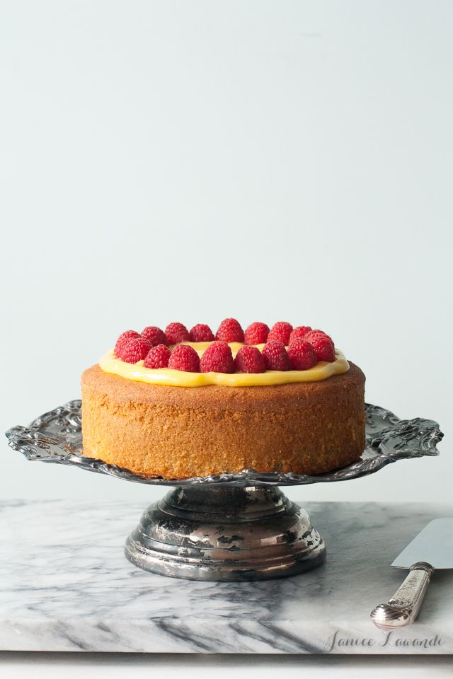 Gluten free lemon cake recipe. This cake isn't too difficult to make and does not contain xanthan gum. It's topped with homemade lemon curd and fresh raspberries. The cake has a secret ingredient to make it moist!