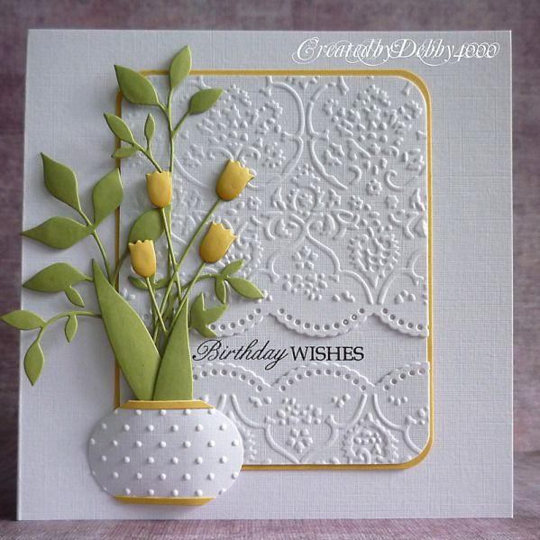 Cuttlebug Embossing folder, Memory box dies of Pearl Lace, Fresh Foliage, Tulips and Stampin Up Bauble punch.