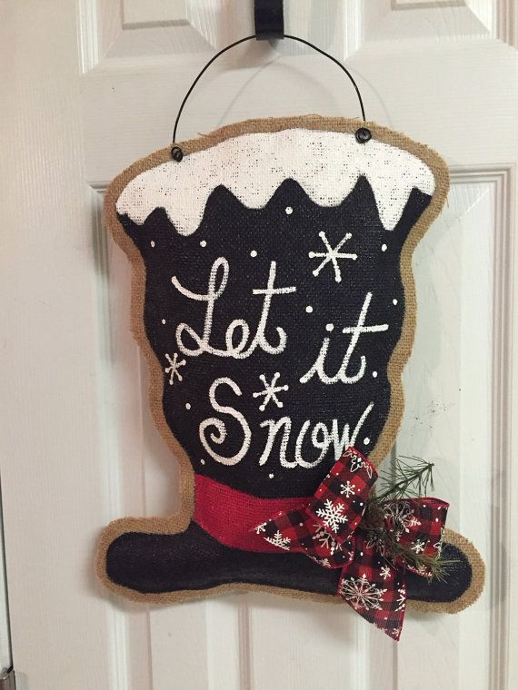 This stuffed burlap door hanger adds a rustic wintery touch to your Christmas decor. It is hand painted and sprayed with an acrylic top coat